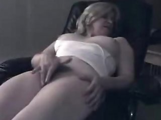 Light-complexioned chick masturbates on an obstacle chair