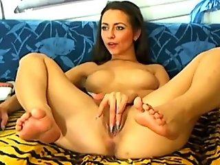 Slutty brunette fingering her fur pie