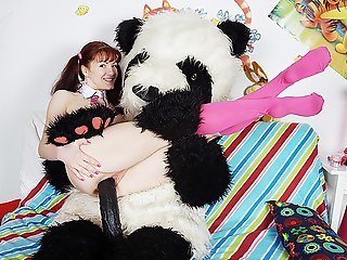 Morose girl fucks far nasty panda bear