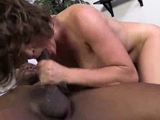 Hot Cougar cums hard on young black cock 13